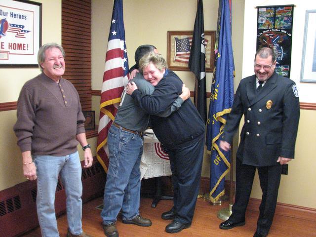 Overcome with emotion, Kim gives Commander Hernandez a big hug in appreciation!