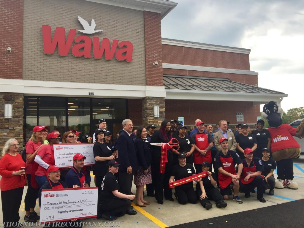 Everyone poses for a group picture in front of the new Wawa.